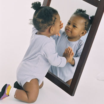Child in front of a mirror
