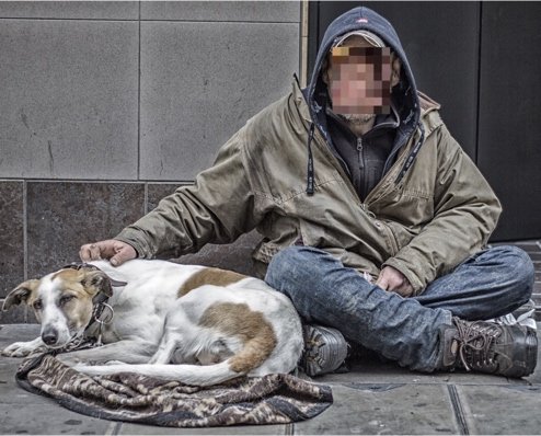 Photograph of homeless man with dog
